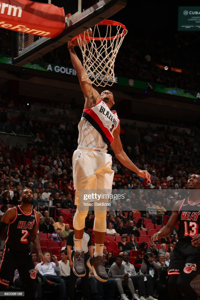 CJ McCollum #3 of the Portland Trail Blazers goes to the basket against the Miami Heat on December 13, 2017 at American Airlines Arena in Miami, Florida.
