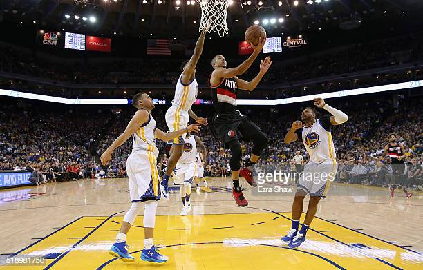 J McCollum of the Portland Trail Blazers goes up for a shot against Stephen Curry Brandon Rush and Leandro Barbosa of the Golden State Warriors at...