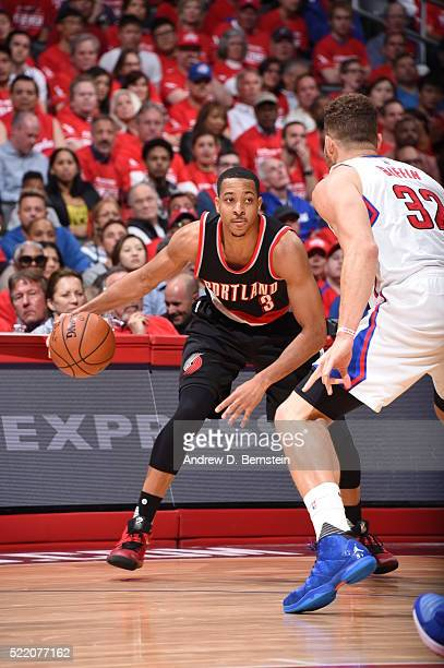 J McCollum of the Portland Trail Blazers handles the ball against Blake Griffin of the Los Angeles Clippers in Game One of the Western Conference...