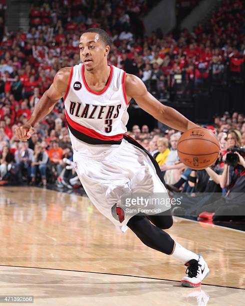 J McCollum of the Portland Trail Blazers handles the ball against the Memphis Grizzlies in Game Four of the Western Conference Quarterfinals during...