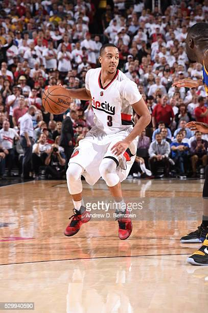 J McCollum of the Portland Trail Blazers handles the ball against the Golden State Warriors in Game Four of the Western Conference Semifinals during...