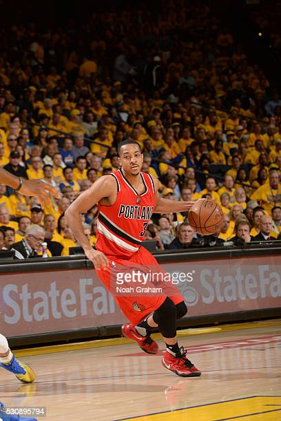J McCollum of the Portland Trail Blazers handles the ball against the Golden State Warriors in Game Five of the Western Conference Semifinals on May...