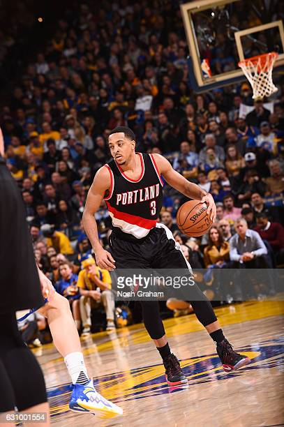 J McCollum of the Portland Trail Blazers handles the ball against the Golden State Warriors during the game on January 4 2017 at ORACLE Arena in...