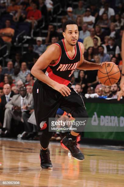 J McCollum of the Portland Trail Blazers handles the ball against the Phoenix Suns on March 12 2017 at Talking Stick Resort Arena in Phoenix Arizona...