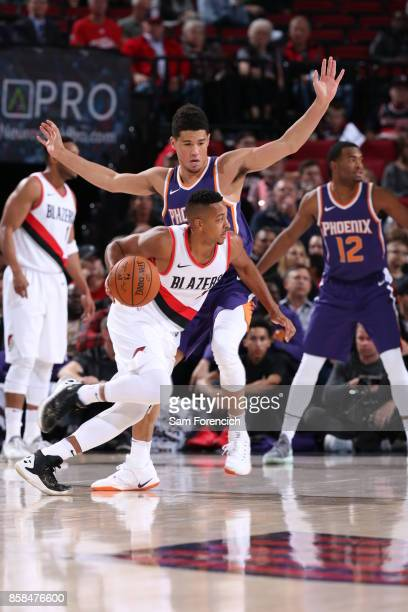 McCollum of the Portland Trail Blazers handles the ball during the preseason game against the Phoenix Suns on October 3 2017 at the Moda Center Arena...