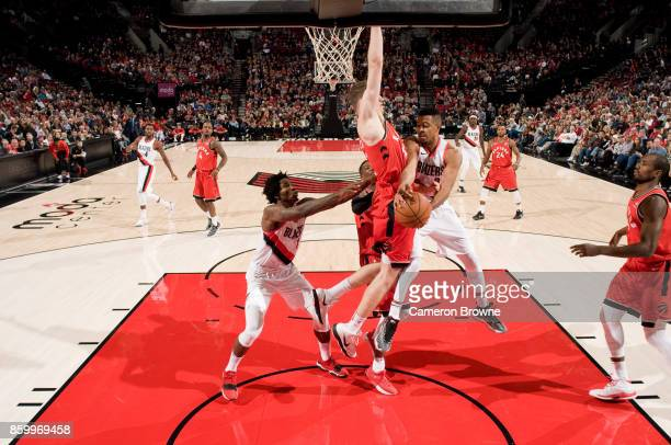 McCollum of the Portland Trail Blazers handles the ball during the preseason game against the Toronto Raptors on October 5 2017 at the Moda Center...