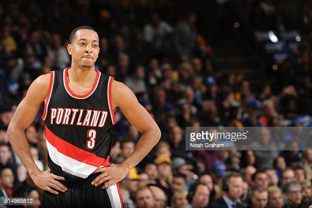J McCollum of the Portland Trail Blazers looks on during the game against the Golden State Warriors on March 11 2016 at Oracle Arena in Oakland...