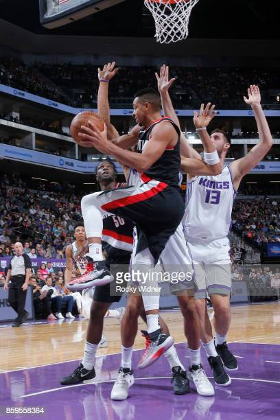 McCollum of the Portland Trail Blazers looks to pass against the Sacramento Kings during a preseason game on October 9 2017 at ORACLE Arena in...