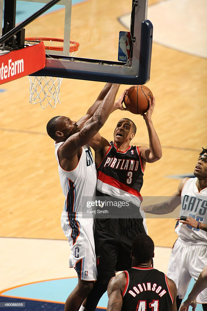 C.J. McCollum #3 of the Portland Trail Blazers shoots against Bismack Biyombo #0 of the Charlotte Bobcats at the Time Warner Cable Arena on March 22, 2014 in Charlotte, North Carolina.