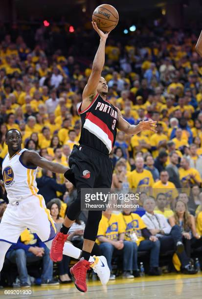 McCollum of the Portland Trail Blazers shoots against the Golden State Warriors in the fourth quarter during Game One of the first round of the 2017...