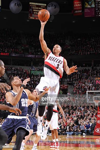 J McCollum of the Portland Trail Blazers shoots against the Oklahoma City Thunder on February 11 2014 at the Moda Center Arena in Portland Oregon...