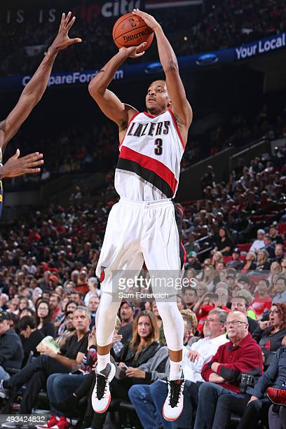 J McCollum of the Portland Trail Blazers shoots the ball against the Utah Jazz during a preseason game on October 18 2015 at the Moda Center Arena in...