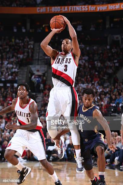 J McCollum of the Portland Trail Blazers shoots the ball against the New Orleans Pelicans on October 28 2015 at the Moda Center in Portland Oregon...