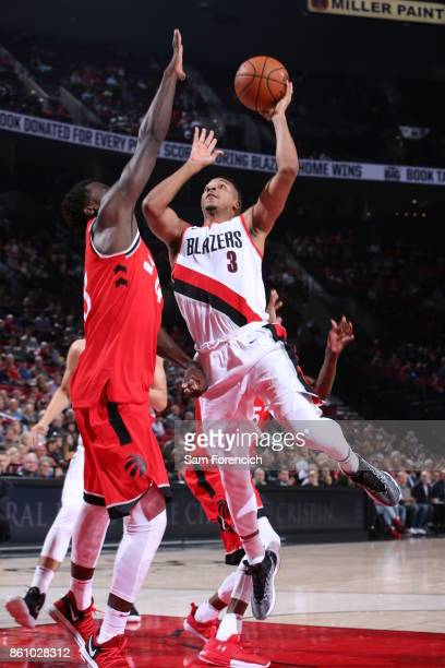 McCollum of the Portland Trail Blazers shoots the ball during a pre season game against the Toronto Raptors on October 5 2017 at the Moda Center in...