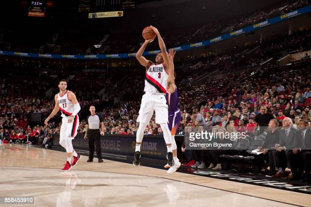 McCollum of the Portland Trail Blazers shoots the ball during the preseason game against the Phoenix Suns on October 3 2017 at the Moda Center Arena...