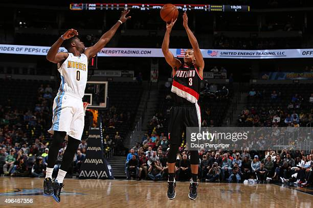 J McCollum of the Portland Trail Blazers takes a shot over Emmanuel Mudiay of the Denver Nuggets at Pepsi Center on November 9 2015 in Denver...