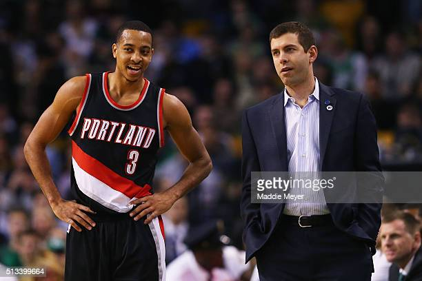 J McCollum of the Portland Trail Blazers talks with Brad Stevens of the Boston Celtics during the second quarter at TD Garden on March 2 2016 in...