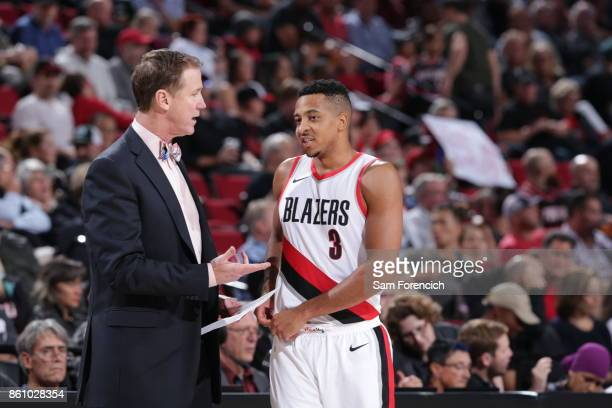 McCollum of the Portland Trail Blazers talks with head coach Terry Stotts during a pre season game against the Toronto Raptors on October 5 2017 at...