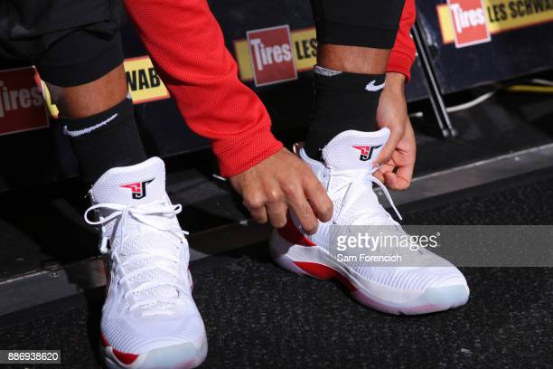 McCollum of the Portland Trail Blazers ties his sneakrers before the game against the Washington Wizards on December 5 2017 at the Moda Center in...