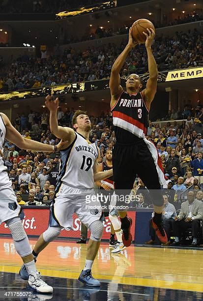 J McCollum of the Portland Trailblazers takes a shot over Beno Udrih of the Memphis Grizzlies during the second half of Game 5 of the first round of...