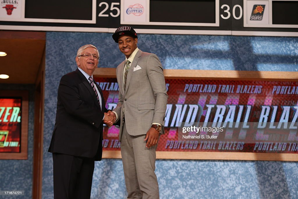 C.J. McCollum shakes hands with NBA Commissioner, David Stern after being selected number ten overall by the Portland Trail Blazers during the 2013 NBA Draft on June 27, 2013 at Barclays Center in Brooklyn, New York.