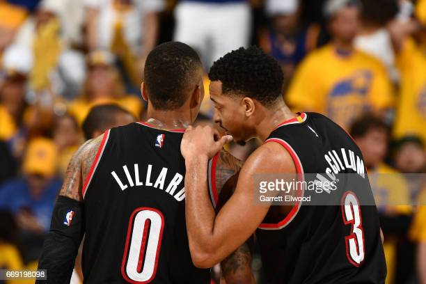 J McCollum talks with Damian Lillard of the Portland Trail Blazers during the game against the Golden State Warriors during the Western Conference...