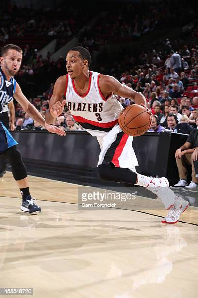 J McCollum the Portland Trail Blazers handles the ball against the Dallas Mavericks on November 6 2014 at the Moda Center Arena in Portland Oregon...
