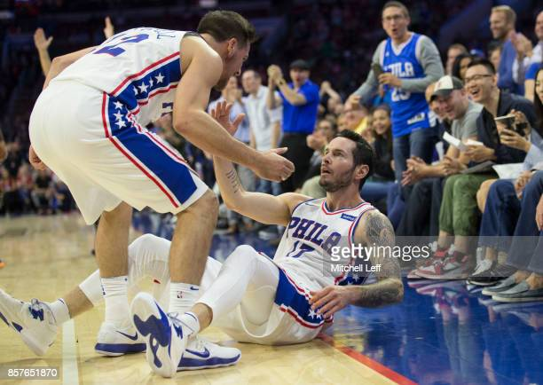 J McConnell and JJ Redick of the Philadelphia 76ers react in the second quarter of the preseason game against the Memphis Grizzlies at the Wells...