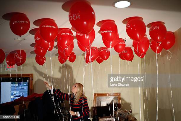 McConnell campaign volunteer Kara Townsend of London Ky arranges balloons before a campaign event for Senate Minority Leader Mitch McConnell at the...