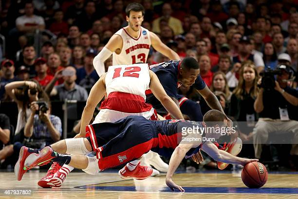 J McConnell of the Arizona Wildcats dives for a loose ball against Traevon Jackson of the Wisconsin Badgers in the second half during the West...