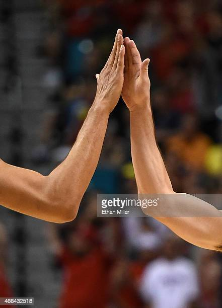 J McConnell of the Arizona Wildcats gets a highfive from teammate Brandon Ashley after McConnell scored against the Oregon Ducks during the...