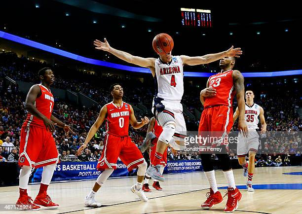 J McConnell of the Arizona Wildcats goes up between Amir Williams and D'Angelo Russell of the Ohio State Buckeyes in the first half during the third...