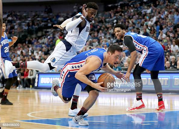 McConnell of the Philadelphia 76ers dribbles the ball against Wesley Matthews of the Dallas Mavericks in the first half at American Airlines Center...
