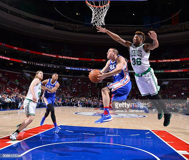 J McConnell of the Philadelphia 76ers goes up for the reverse layup against the Boston Celtics at Wells Fargo Center on January 24 2015 in...