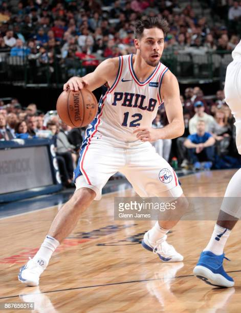 J McConnell of the Philadelphia 76ers handles the ball against the Dallas Mavericks on October 28 2017 at the American Airlines Center in Dallas...