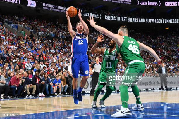 J McConnell of the Philadelphia 76ers shoots the ball against the Boston Celtics during the game on October 20 2017 at Wells Fargo Center in...