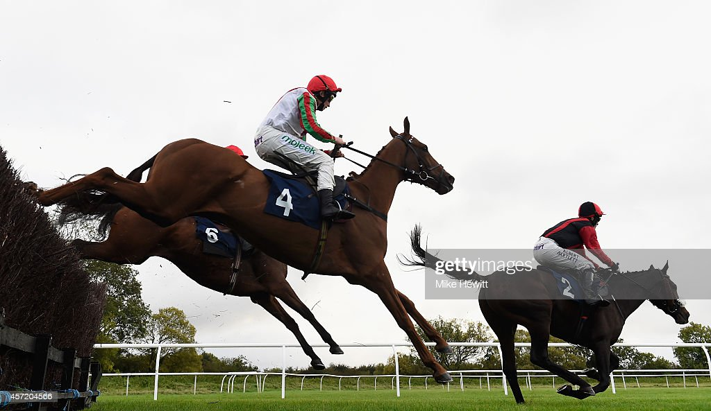 McCoy and Druid's Nephew jump ahead of Jamie Moore on Book'em Danno on their way to victory in the ERS Medical Handicap Chase at Huntingdon...