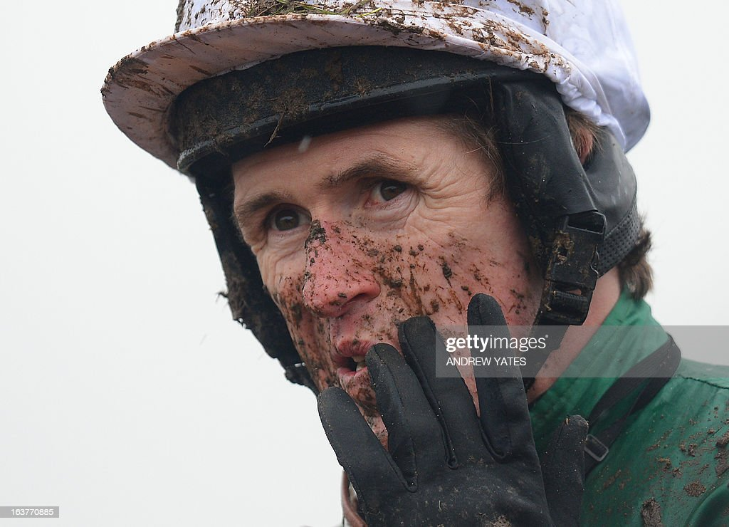 A P McCoy finishes an early race covered in mud during a rain lashed last day of the Cheltenham horse racing festival in Gloucestershire, England on March 15, 2013.