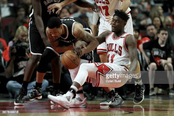 McDaniels of the Brooklyn Nets and Anthony Morrow of the Chicago Bulls battle for a loose ball in the fourth quarter at United Center on April 12...