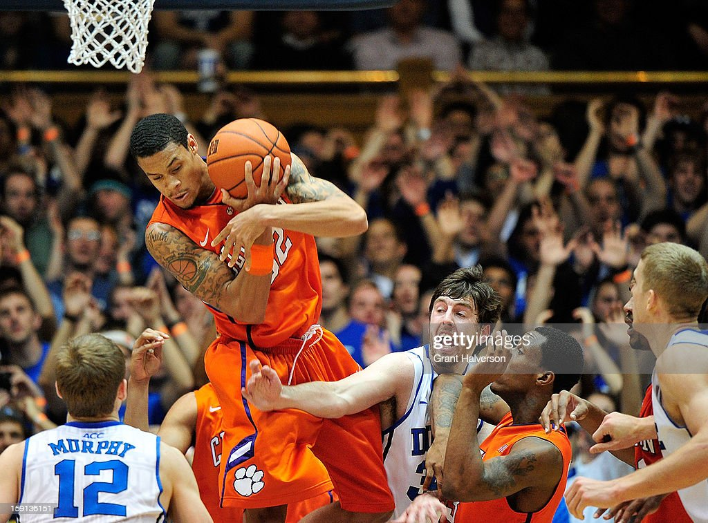 K.J. McDaniels #32 of the Clemson Tigers pulls down a rebound against <a gi-track='captionPersonalityLinkClicked' href=/galleries/search?phrase=Ryan+Kelly+-+Basketball+Player&family=editorial&specificpeople=15185169 ng-click='$event.stopPropagation()'>Ryan Kelly</a> #34 of the Duke Blue Devils during play at Cameron Indoor Stadium on January 8, 2013 in Durham, North Carolina.