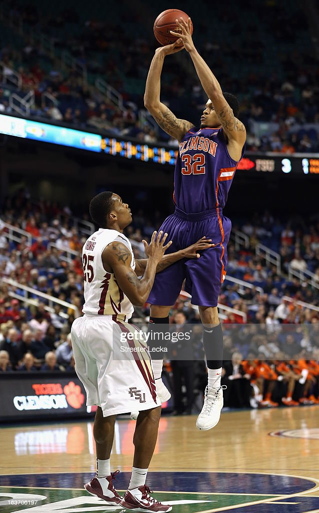K.J. McDaniels #32 of the Clemson Tigers shoots over Aaron Thomas #25 of the Florida State Seminoles during the first round of the Men's ACC Basketball Tournament at Greensboro Coliseum on March 14, 2013 in Greensboro, North Carolina.