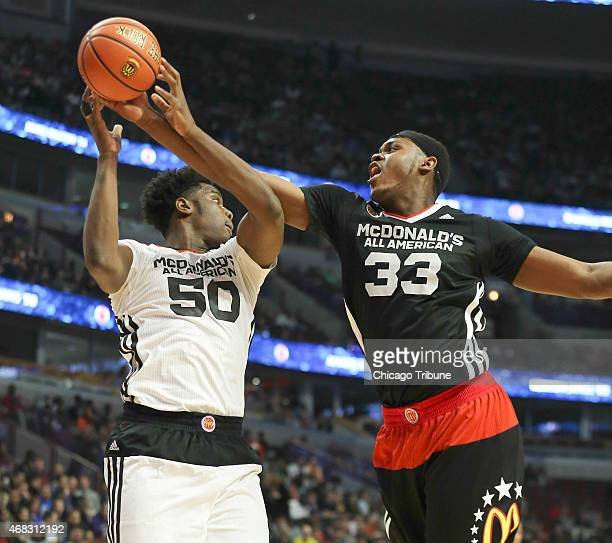 McDonald's All American East team's Diamond Stone tries to get a rebound away from the West team's Caleb Swanigan during the first half of their game...