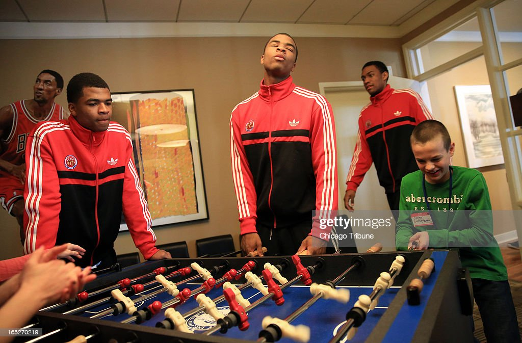 McDonald's All-American Andrew Harrison watches as his brother Aaron Harrison reacts to losing at foosball with Cooper Cunningham, 10, during a visit to Ronald McDonald House in Chicago, Illinois, Sunday, March 31, 2013. Both brothers will be attending Kentucky in the fall.