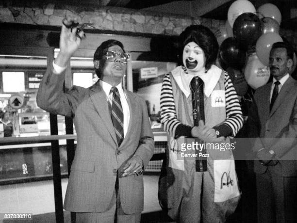 McDonalds at DGH Mayor Pena holds up DGH doctor's scissors that how used to cut the ceremonial ribbon to open the McDonalds Next to him stands the...