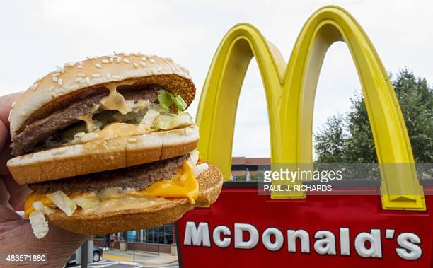 A McDonald's Big Mac their signature sandwich is held up near the golden arches at a McDonalds's August 10 in Centreville Virginia AFP PHOTO/PAUL J...