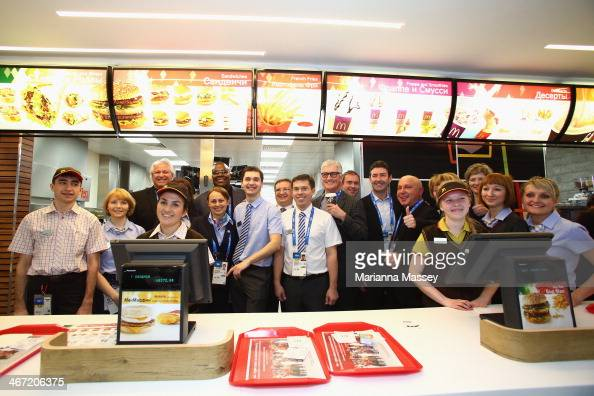McDonald's CEO Don Thompson and executives visit with McDonald's Olympic Champion Crew at the McDonald's restaurant in the Athletes Village ahead of...