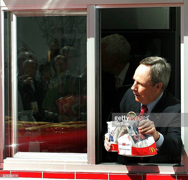McDonald's CEO Jim Skinner is seen in the drivethru window during the opening celebration of the new 50th Anniversary McDonald's April 15 2005 in...