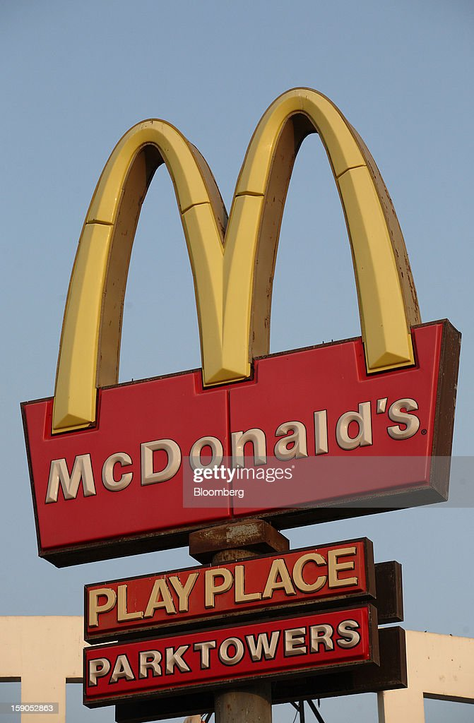 McDonald's Corp. signage is displayed outside one of the company's outlets in Karachi, Pakistan, on Saturday, Jan. 5, 2013. Fatburger opened its first outlet in Pakistan to the public on Jan. 5. Photographer: Asim Hafeez/Bloomberg via Getty Images
