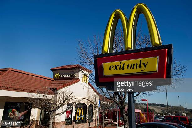 McDonald's Corp signage stands outside of a restaurant in San Pablo California US on Wednesday Jan 22 2014 McDonald's Corp the worlds largest...