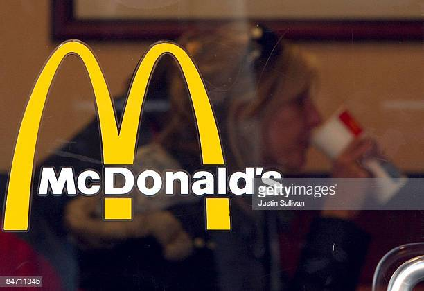 McDonald's customer is seen through the window at a McDonald's restaurant February 9 2009 in San Francisco California Fast food chain restaurant...
